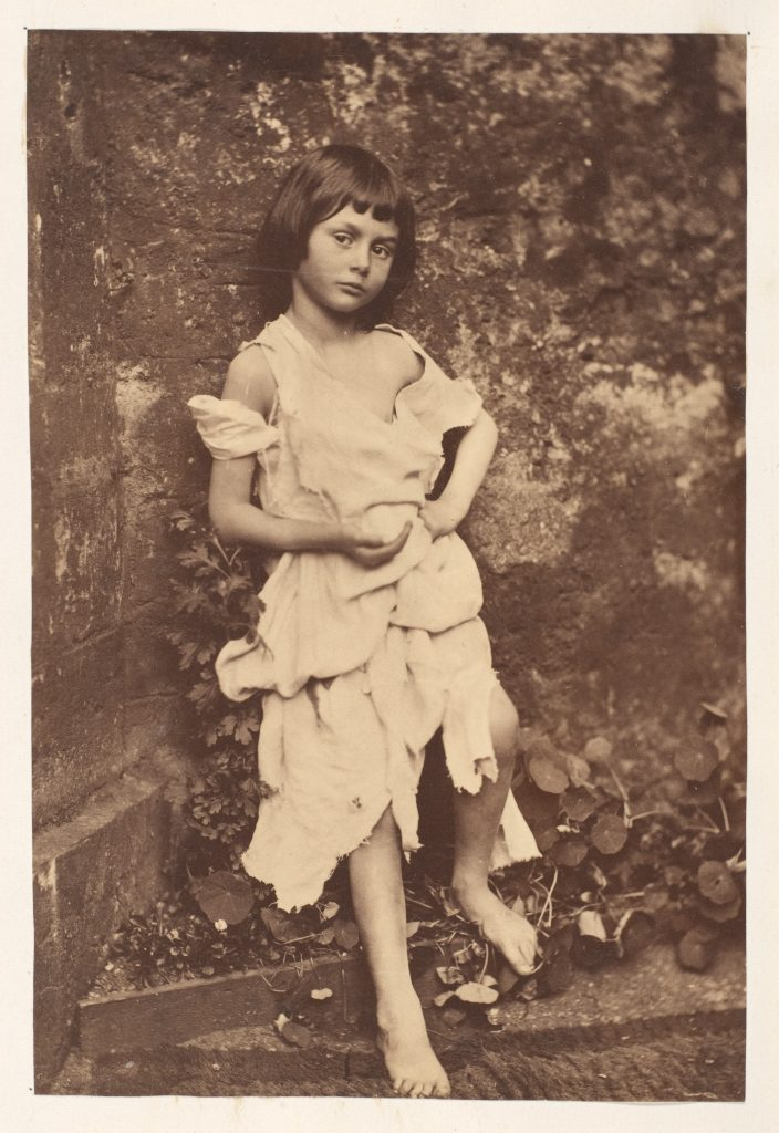 An albumen print of Alice Liddell posing as the Beggar Maid by Charles Dodgson.