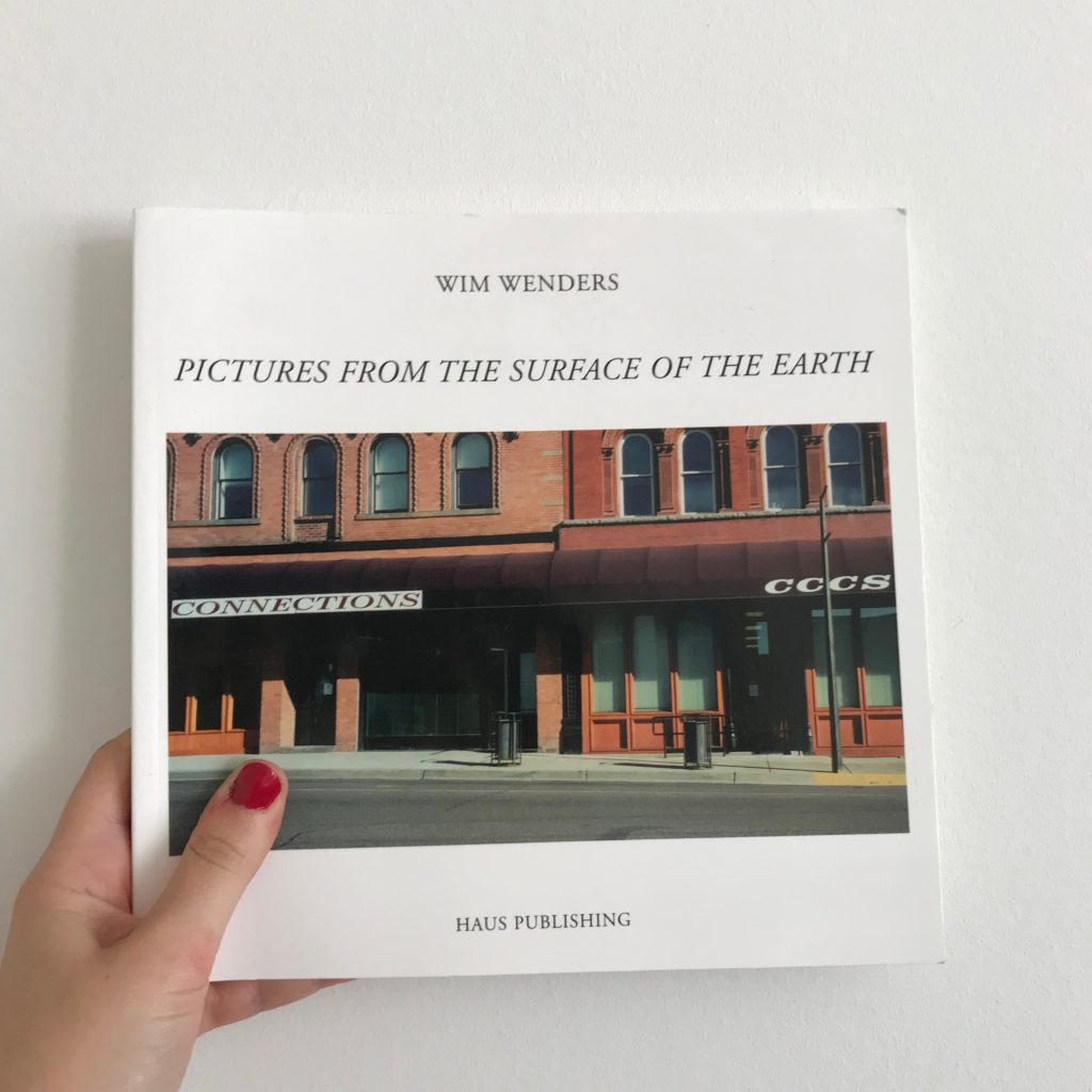 A photograph of the frontispiece of Wim Wenders's book 'Pictures from the Surface of the Earth'.